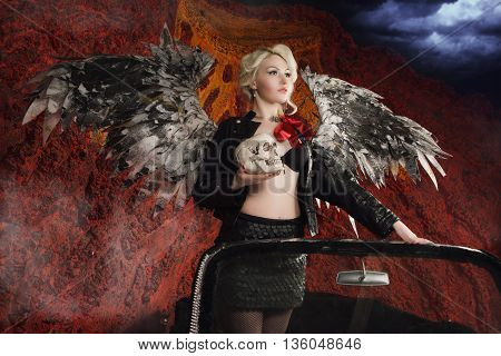 Pin Up Girl Posing In A Classic Car As Dark Angel With Skull