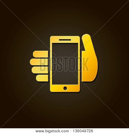 Mobile phone in hand - gold icon or logo on black background