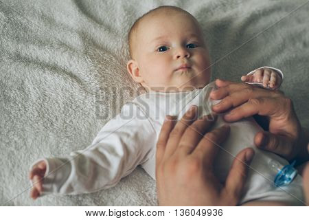 Infant Baby Portrait With Fathers Hands