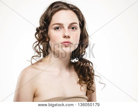 Beautiful Woman Face With Curly Flying Hair Studio On White