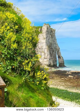 Cote d'Albatre or Alabaster Coast is part of the French coast of the English Channel. Famous cliff Porte d'Aval. Etretat, France,