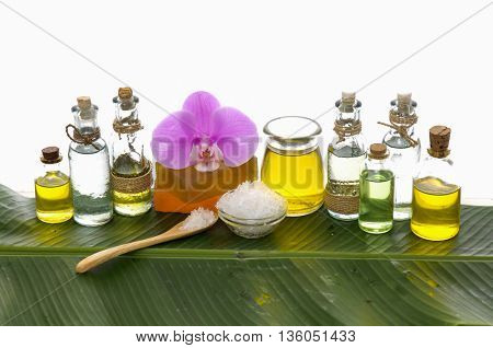 health spa with pebbles ,candle, orchid and banana leaf