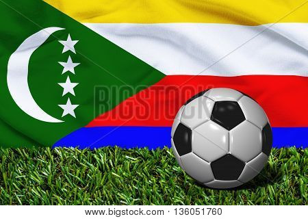 Soccer Ball On Grass With Comoros Flag Background, 3D Rendering
