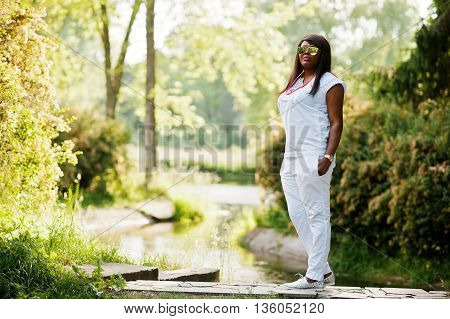 African Woman At National White Clothes And Sunglasses