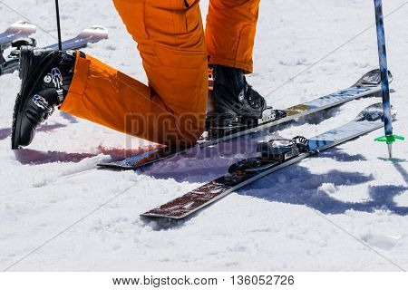 Adjust and prepare Snowshoes before skiing Skiing equipment and extreme winter sports at place for skiing