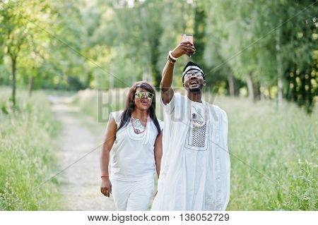 Happy Cheerful Black African Couple In Love Doing Selfie On They Phone