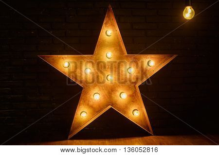 big star with lights on black background