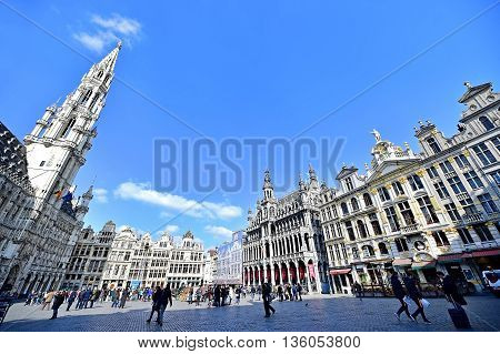 BRUSSELS BELGIUM - MARCH 16: Day scene with tourists visiting the Grand Place on March 16 2016 in Brussels.