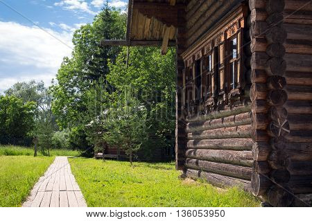 Country log house with window platband in russian style