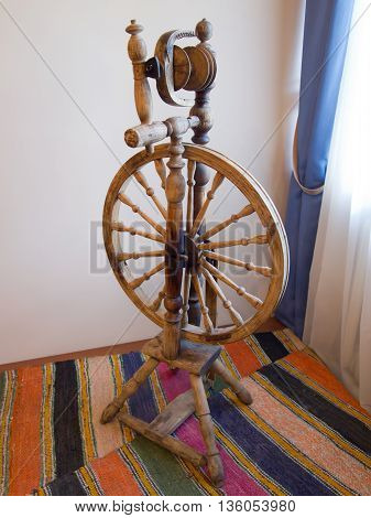 Former Russian old spinning wheel for thread