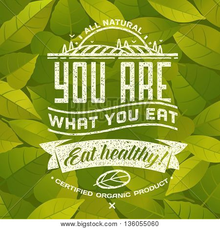 You are what you eat - Eat healthy. Healthy eating quote on background with fresh green leaves. Natural, locally grown, organic food poster or banner. Vector illustration.