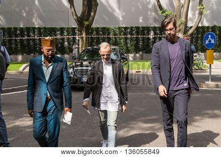 MILAN ITALY - JUNE 21: Fashionable man poses outside Armani fashion show building during Milan Men's Fashion Week on JUNE 21 2016 in Milan.