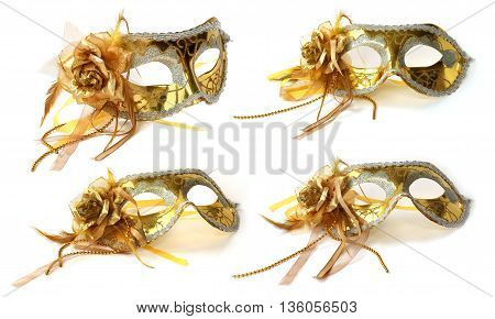 Mask Golden with the flower of taffeta for carnival or theater
