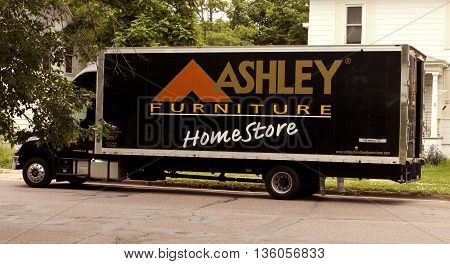 RIVER FALLSWISCONSIN-JUNE 26, 2016: An Ashley Furniture truck delivering new items to a urban residence.