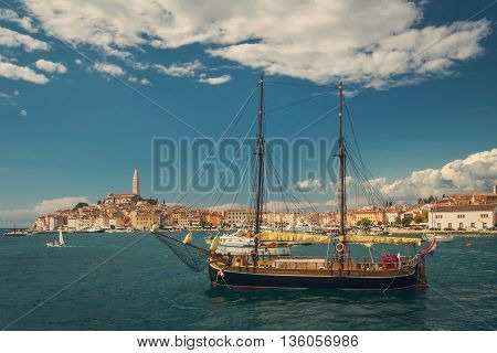 Old sailboat in the bay of old town Rovinj in Croatia, view from the water