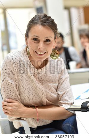 Cheerful businesswoman sitting in office