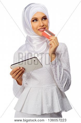 Muslim woman with tablet PC and plastic card isolated