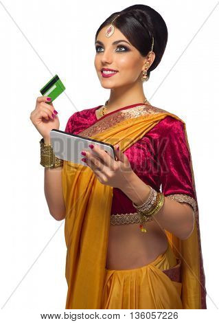 Indian woman with plastic card and tablet PC isolated