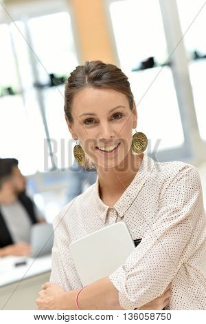 Portrait of smiling businesswoman in meeting room