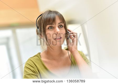 Attractive young sales representative with headset