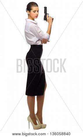 Young businesswoman with gun isolated