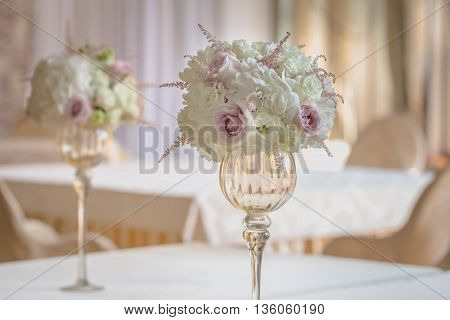 flower composition on the table in the restaurant