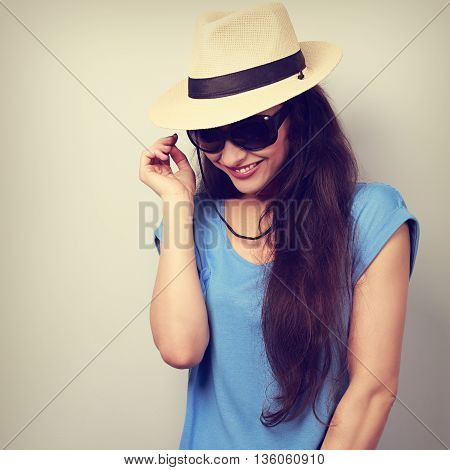 Happy Casual Laughing Woman In Sun Glasses And Hat Looking Down. Toned Closeup Portrait
