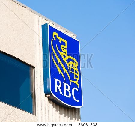 BURNSIDE CANADA - JUNE 26 2016: RBC sign on office building. The Royal Bank of Canada or RBC is Canada's largest bank. RBC is headquartered in Toronto ON.