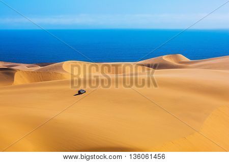 The west coast of the Atlantic Ocean. Giant moving sand dunes. Sandwich Harbour - part of Namib-Naukluft National Park