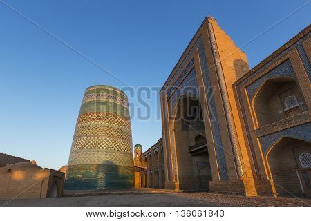 Blue minaret and the madrasah in Khiva, Uzbekistan.