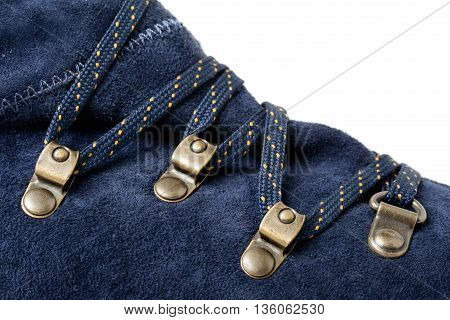 closeup detail of lace on blue suede shoes