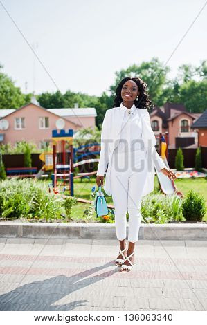 Happy African American Girl At White Dress In City Background Playground