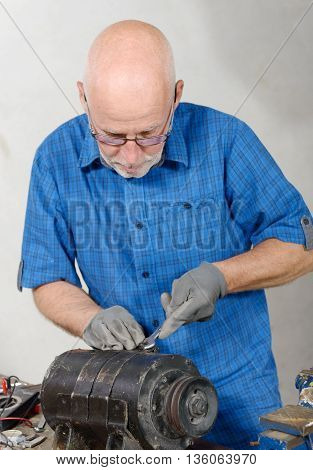 a man with antique generator for the car