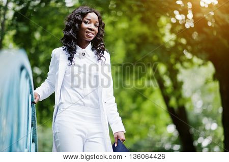 Close Up Portrait Of Stylish And Beautiful Black African American Girl Holding On To The Rail Bridge