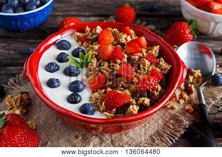 Homemade granola Breakfast with yogurt and fresh fruit berries. concepts health food.