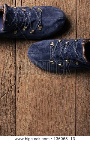 blue suede shoes isolated on wooden plank