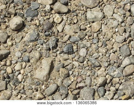 A rough dirty rocky gravel country road