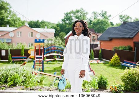 African American Girl With Tears On Face In City Background Playground