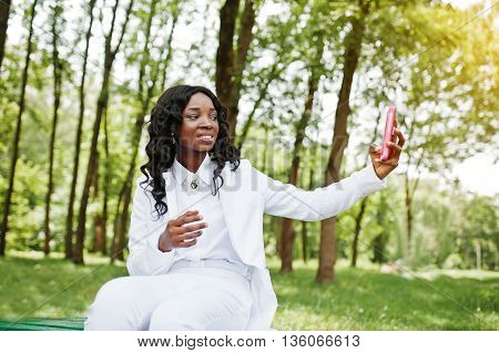 Close Up Portrait Of Stylish Black African American Girl Taking Selfie With Pink Mobile Phone