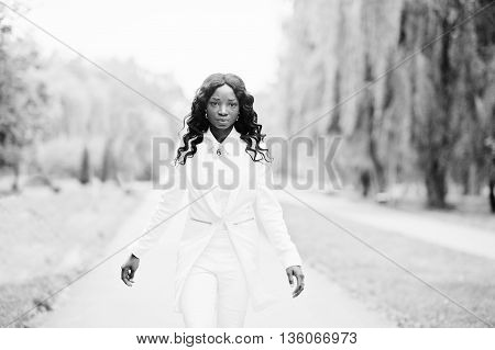 Stylish Black African American Girl Walking On Road In Park