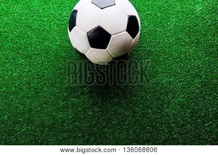 Soccer Ball Against Artificial Turf. Studio Shot. Copy Space.