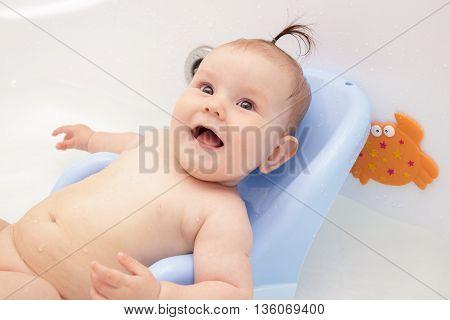 Newborn baby bathe and swim in a large tub