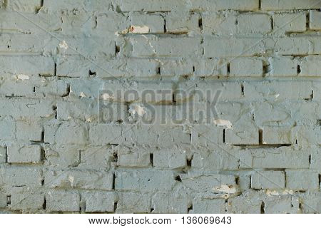 Old brick wall with blue paint and textured.