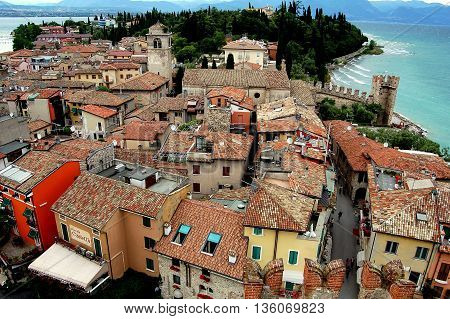 Sirmione Italy - June 1 2006: View of the small spa town with its orange tiled roofs built on a peninsula jutting into Lake Garda