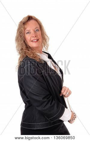 A middle age business woman in a black skirt and navy jacket standing in profile isolated for white background.