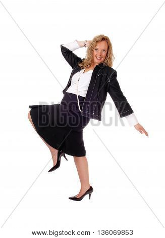 A middle age woman in business attire dancing isolated for white background.