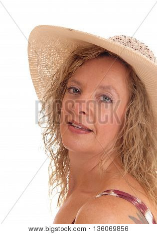 A middle age woman in a summer dress and straw hat in a portrait image isolated for white background.