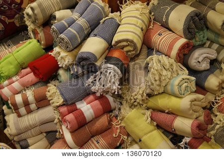 A collection of rolled turkish towels for sale in a local market in calis in turkey,2016