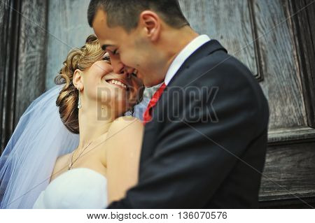 Close Up Portrait Of Wedding Couple In Love