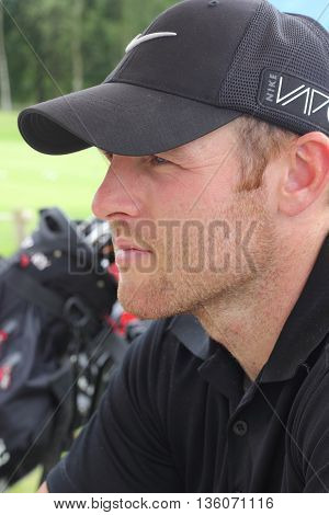 26TH JUNE 2016, BLACKNEST, ENGLAND: A portrait of an englishman on a golf course at blacknest in england, 26th june 2016